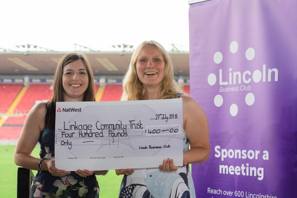 Zoe Easey of Lincoln Business Club presenting Valerie Waby of Linkage a cheque for £400